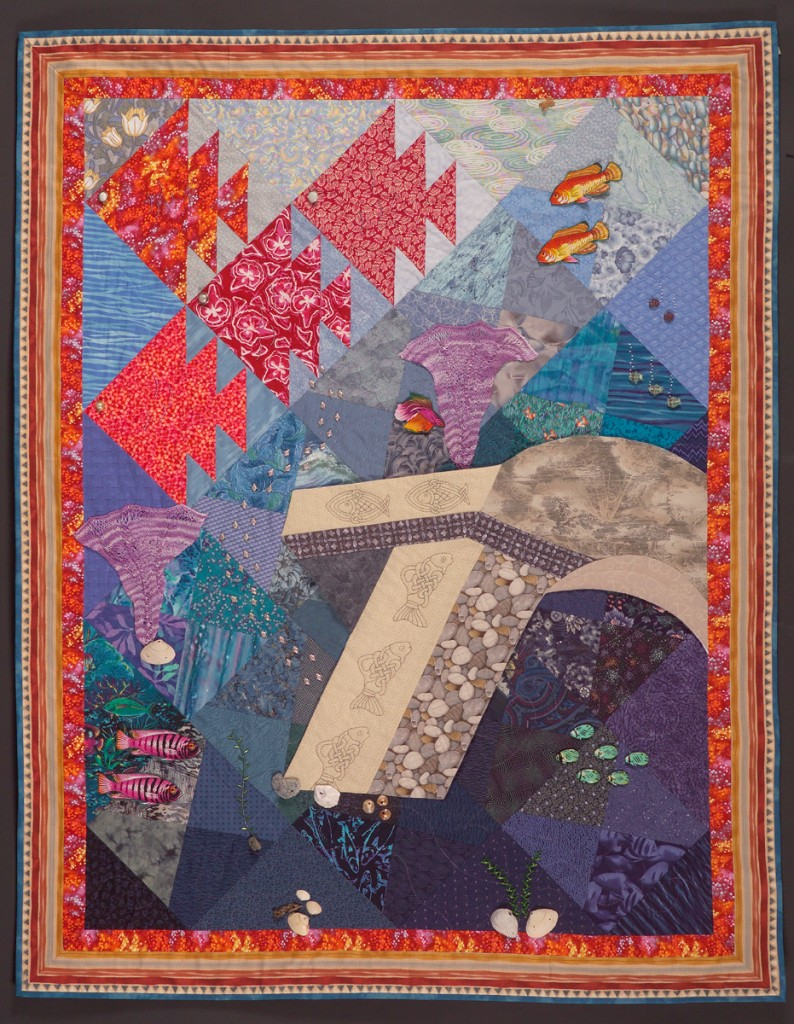 ".......... Atlantis Rising .......... An original design, accepted into the Museum of the American Quilters Society (MAQS) 2005 juried competition on embellishment. Free-flowing pewter, wood, and glass fish; beaded and knitted seaweeds, and a separate arch, pieced and quilted, form this unusual design. 51"" wide x 54 high"". Original design © 2015 by Paula B. Entin. All rights reserved."