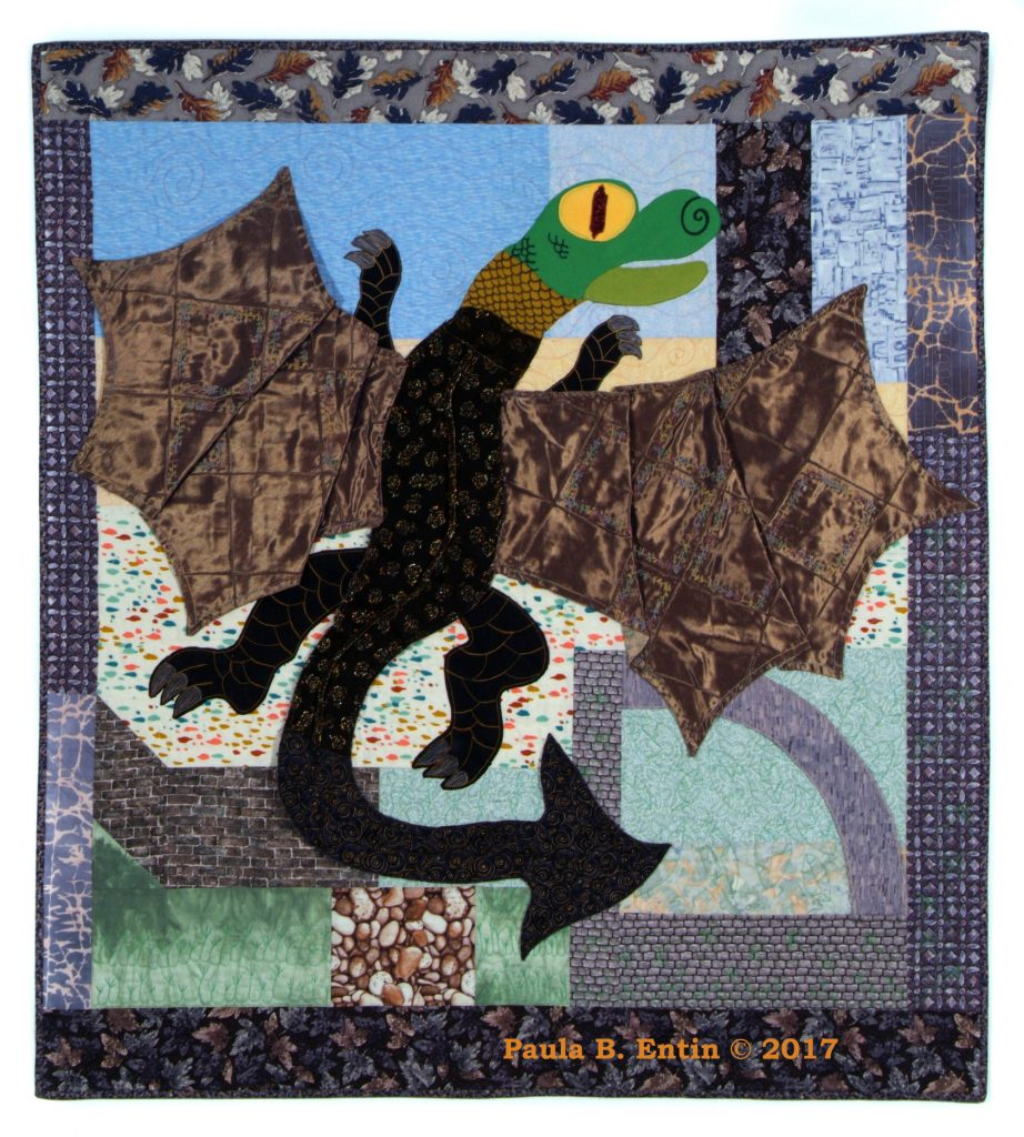 "An exultant dragon leaps into the crystal blue air from the ruins of a castle tower. Beaded and embellished, using a variety of non-traditional fabrics.  39"" wide x 43"" long; sleeve on back for hanging.  Original design © 2017 Paula B. Entin"