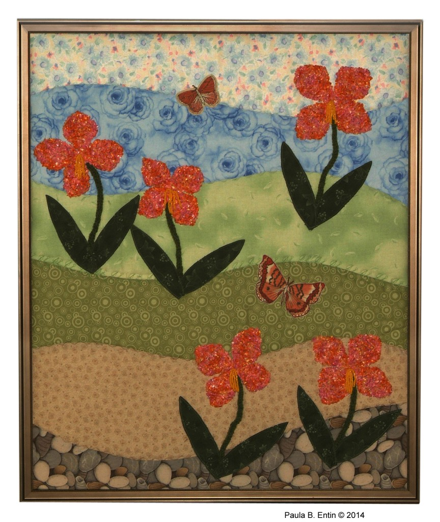 """.......... Field of Flowers II .......... Rich confetti-yarn flowers attract rust orange butterflies in this spring landscape.  Framed; 25"""" wide x 31"""" high.  Original design © 2015 by Paula B. Entin. All rights reserved."""