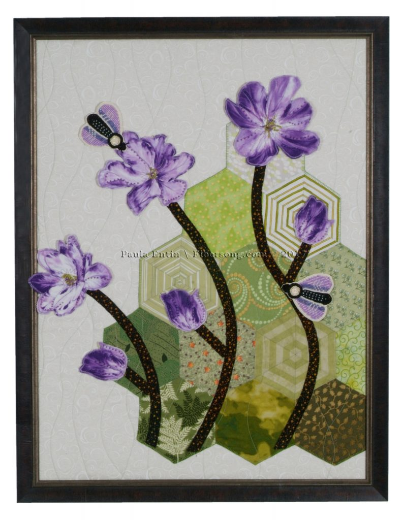 Elegant three dimensional flowers, enhanced by bead embroidered moths, on a gentle garden. 