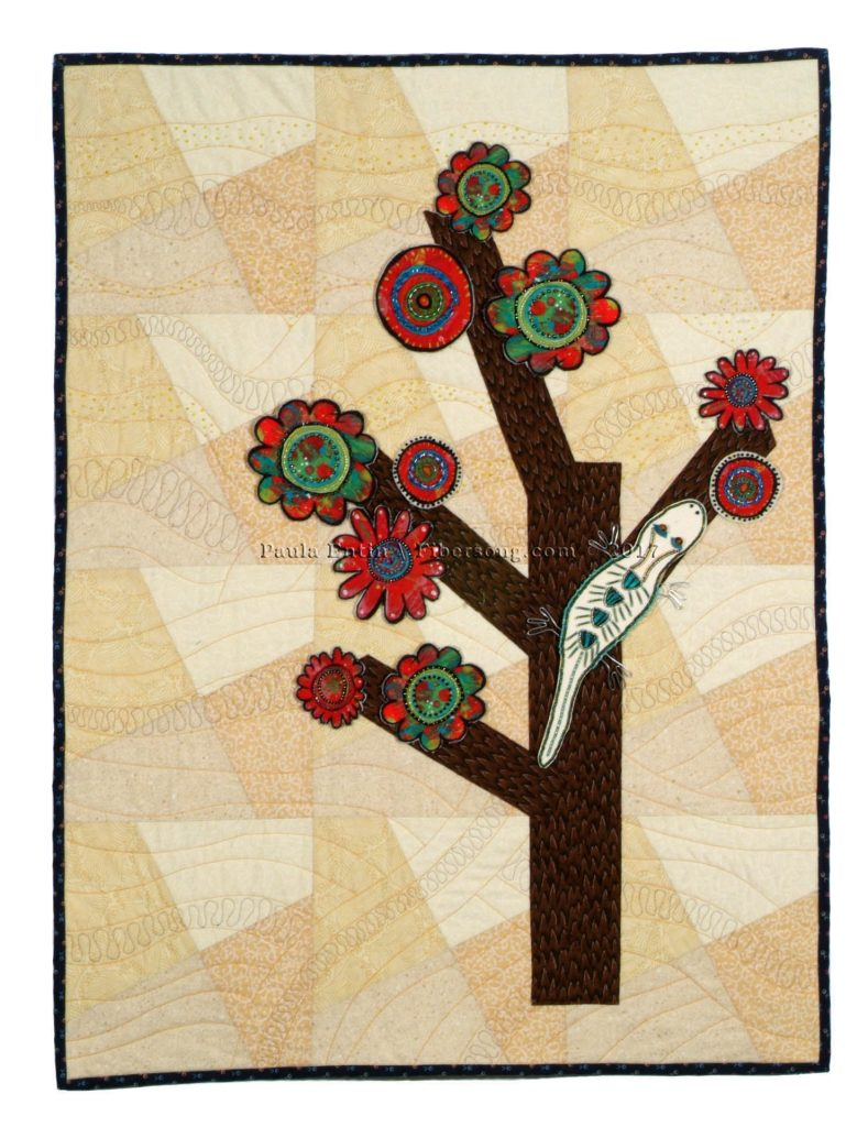 Art quilt with tree, leaves, and beaded lizard.