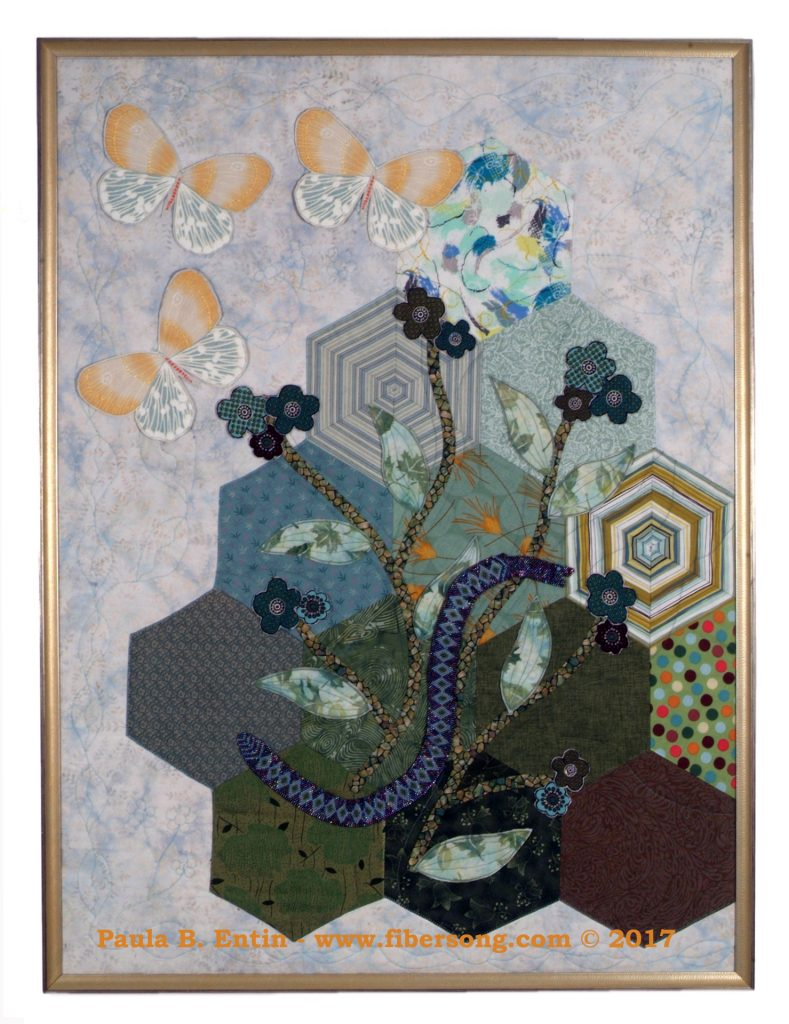 Elegant curving sprays of flowers rest on the first green of the season, as winter gives way to spring. Original design, with a subtle bead-woven snake,  three-dimensional, beaded  flowers, and semi-detached leaves. 