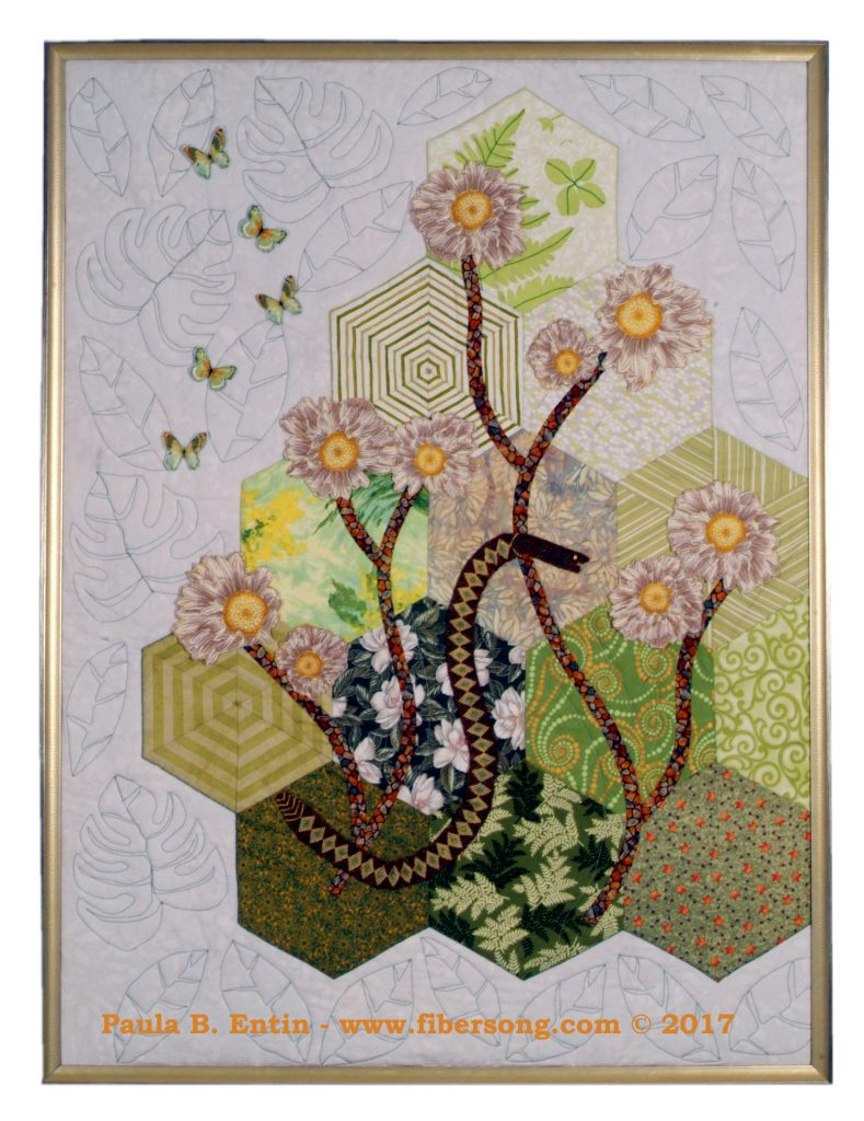 """Elegant curving sprays of flowers rest on the first green of the season, as winter gives way to spring. Original design, with a subtle bead-woven snake,  three-dimensional, beaded  flowers, and semi-detached leaves.   Framed; 28"""" wide x 38"""" high.   Original design © 2017 Paula B. Entin"""