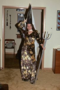 Paula posing in Halloween dress with trident.