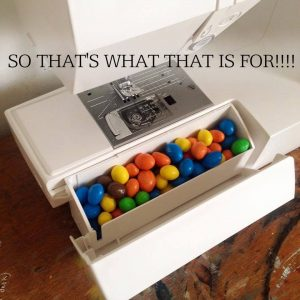 Sewing machine with M&Ms in drawer.